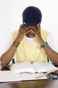 This is an image of a student suffering from academic pressure. This image can be used to represent academic and student themes.